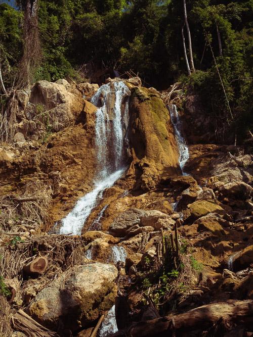 Water flows down the 99th waterfall near Nong Khiaw, Laos