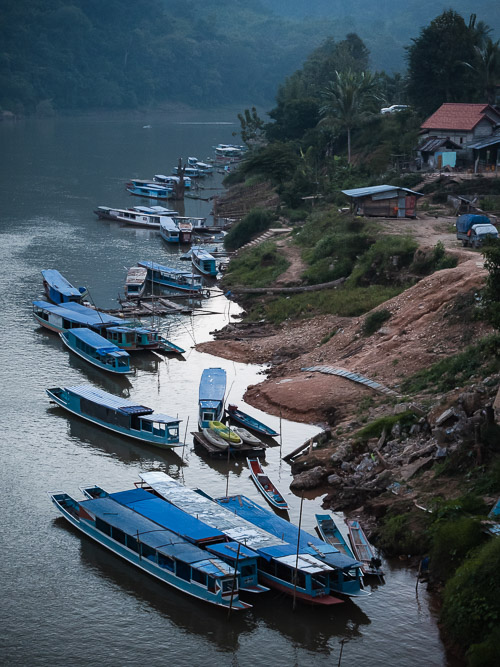 Boats on the river in Nong Khiaw, Laos