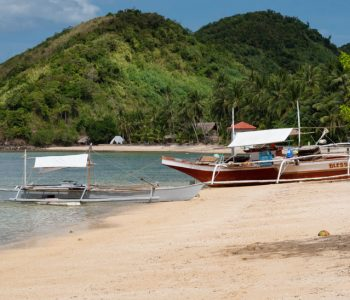 Some boats on the white sands of Ocam Ocam Beach, Busuanga Island, Philippines