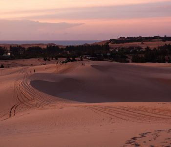 Rolling white sand dunes leading to the sea in Mui Ne, Vietnam