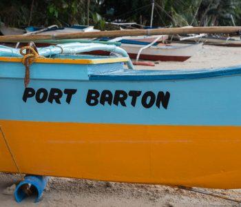 Boat on Port Barton Beach blue and orange