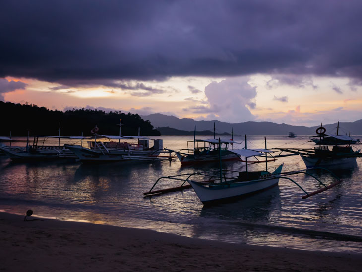 Sunset over the ports at Port Barton Beach in Palawan Philippines