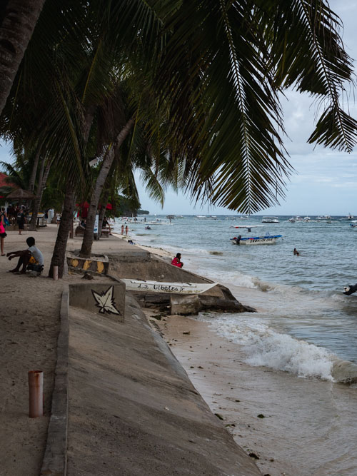 Alona Beach with people and boats in Bohol Philippines