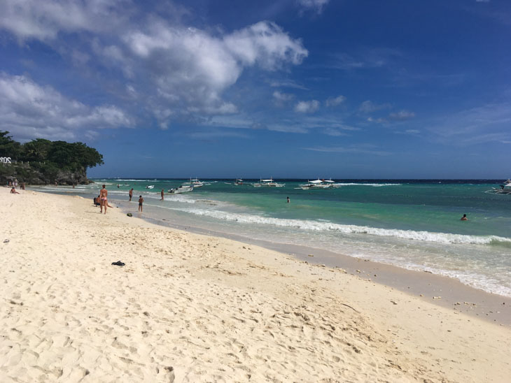 People on sandy beach in Bohol Philippines