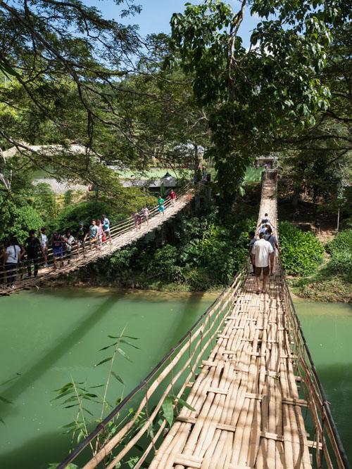 Tourists crossing bamboo bridge in Bohol Philippines