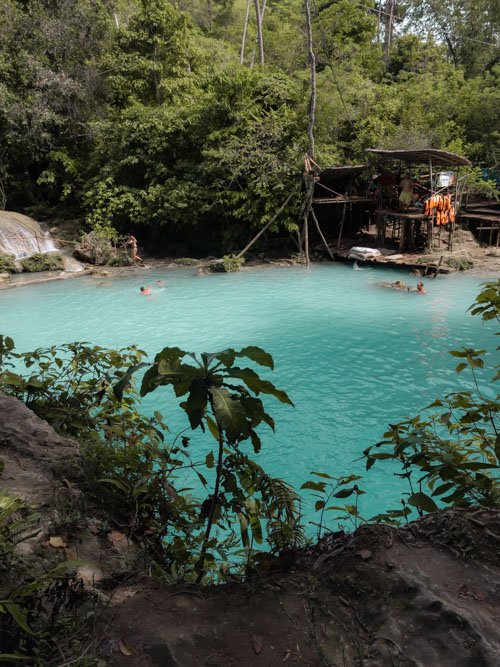 Turquoise waters in the pools of Cambugahay Falls, Siquijor, Philippines