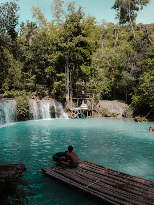 A view from the platform on the turquoise waters at Cambugahay Falls, Siquijor, Philippines