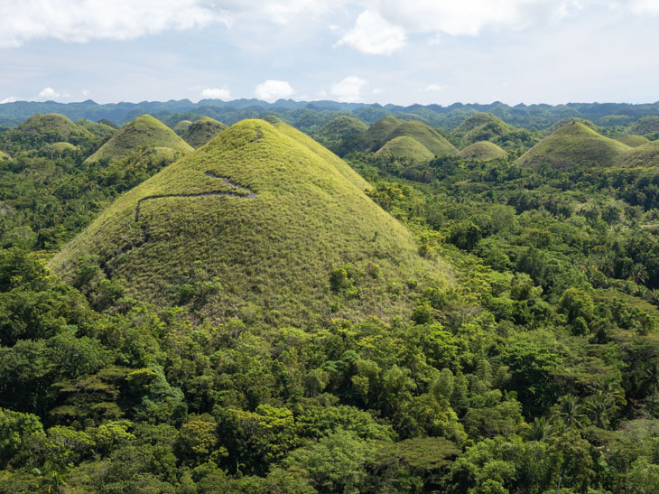 Trail going up one of the Chocolate Hills in Bohol Philippines
