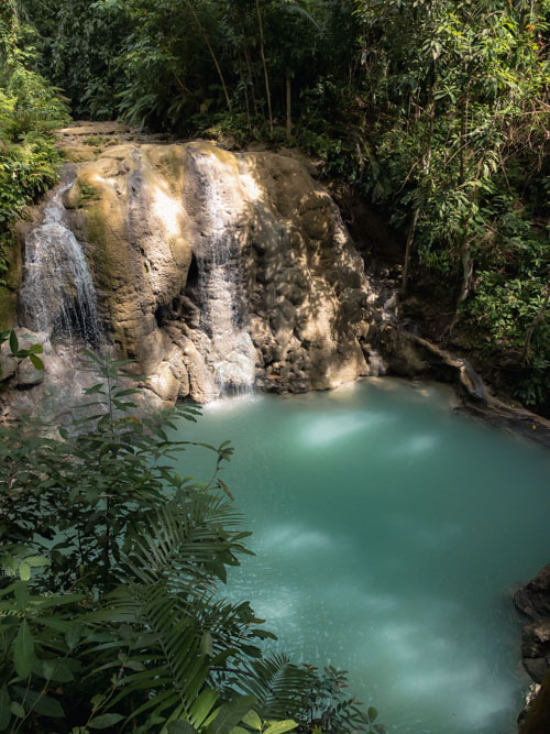 A bird's-eye view of the blue water at Lugnason Falls, Siquijor, Philippines