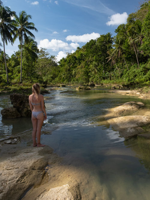 Girl in water with palm trees in Bohol Philippines