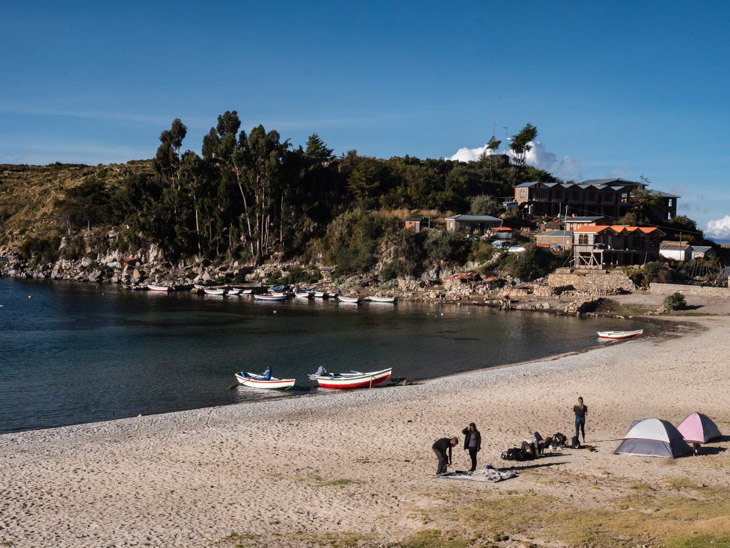 Campers set up their tents on Challapampa Beach, Isla del Sol, Bolivia