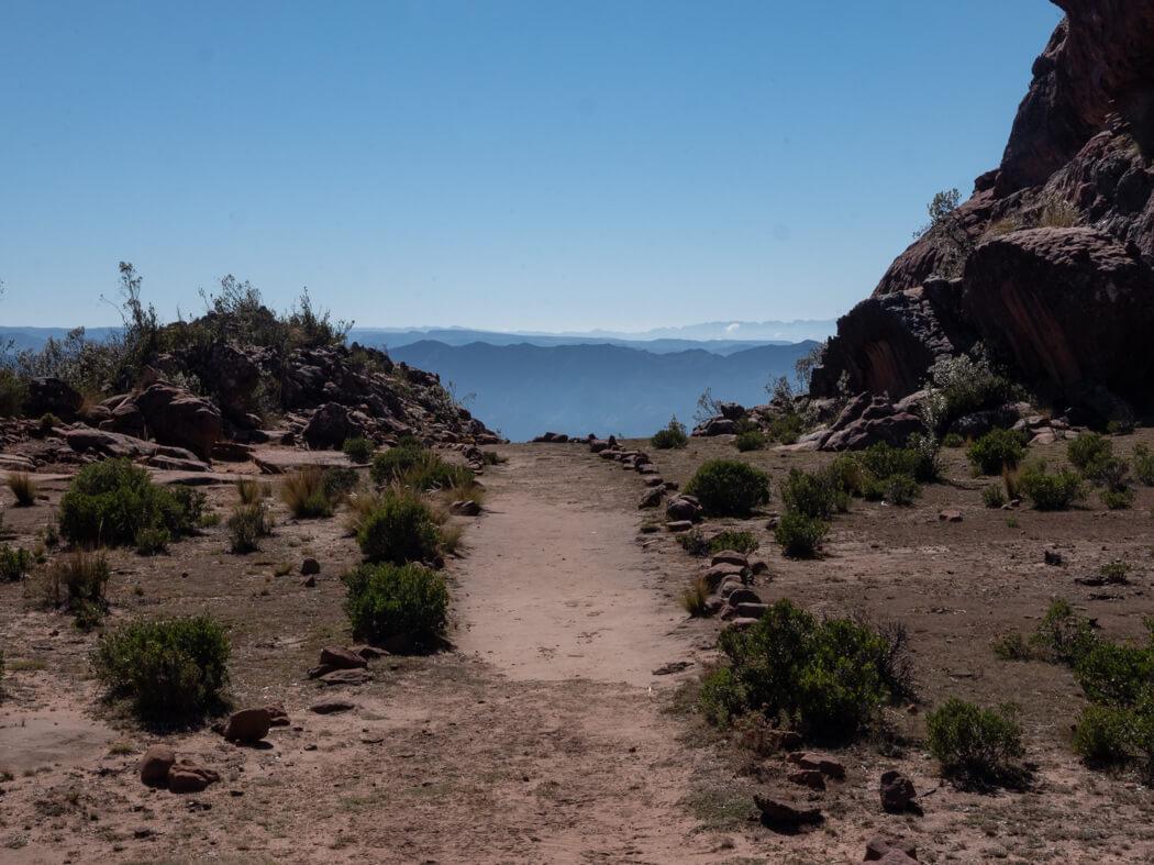 A pathway leads to mountain views at La Ciudad de Itas, Torotoro National Park