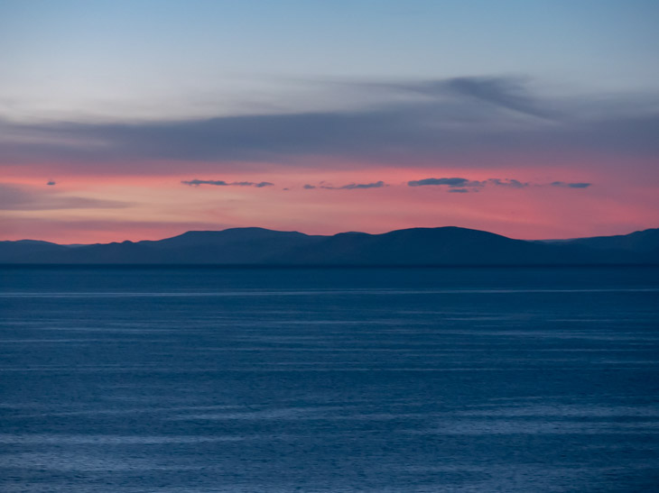 A pink sky after sunset on the north of Isla del Sol, Bolivia