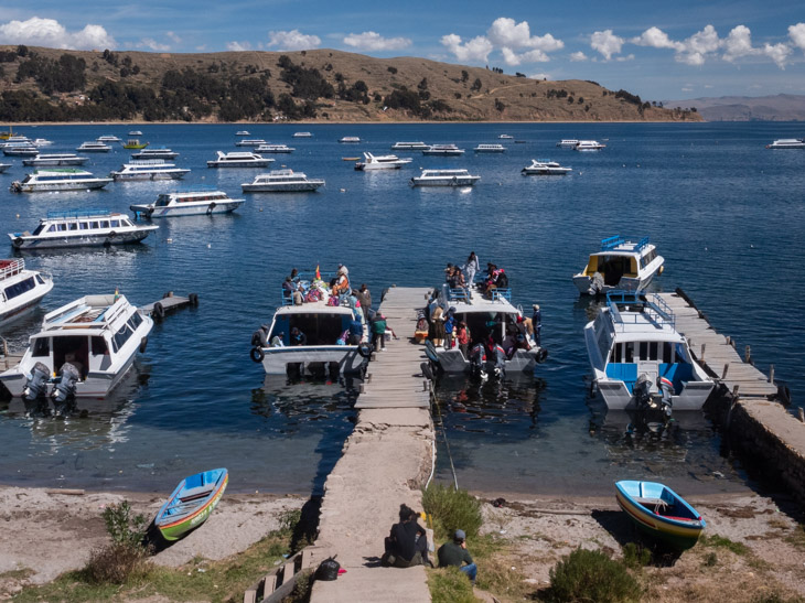Two crowded boats at a pier on Copacabana, Lake Titicaca, Bolivia