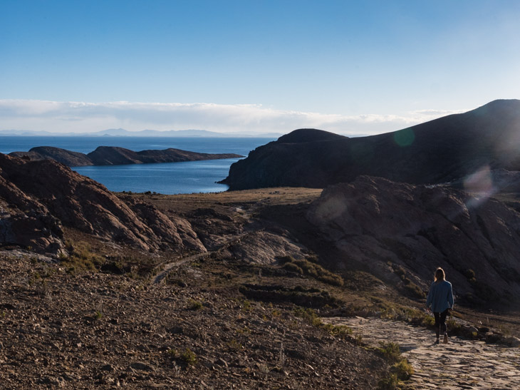 A girl walking on the north coast of Isla del Sol, Bolivia