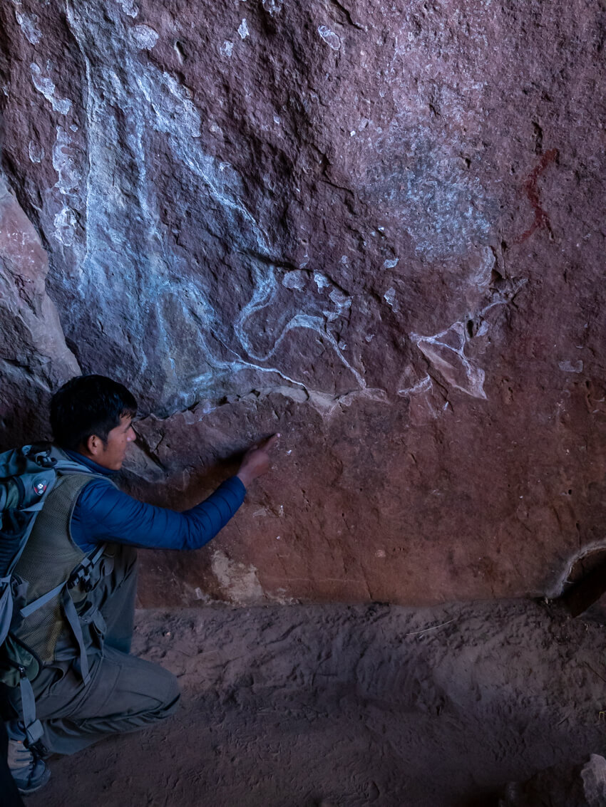 A guide points out cave paintings in La Ciudad de Itas, Torotoro National Park