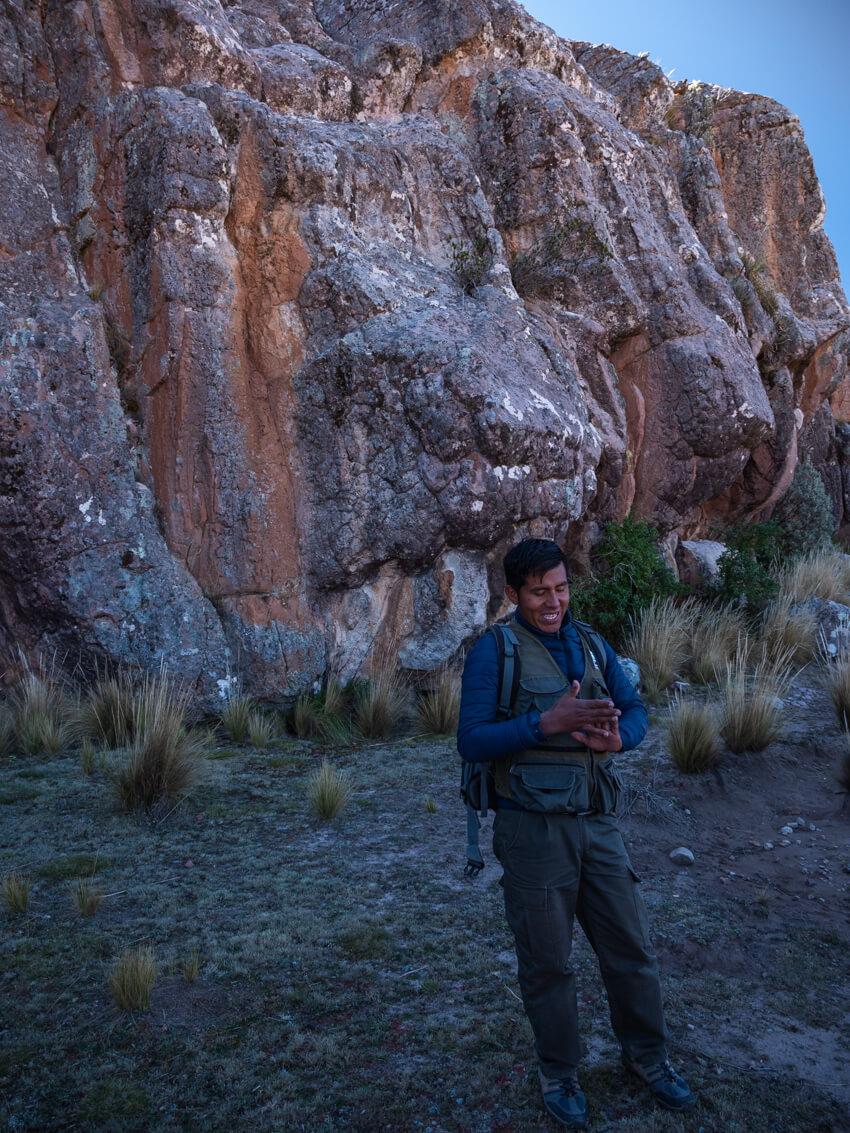 A guide shows unusual rock formations in La Ciudad de Itas, Torotoro National Park