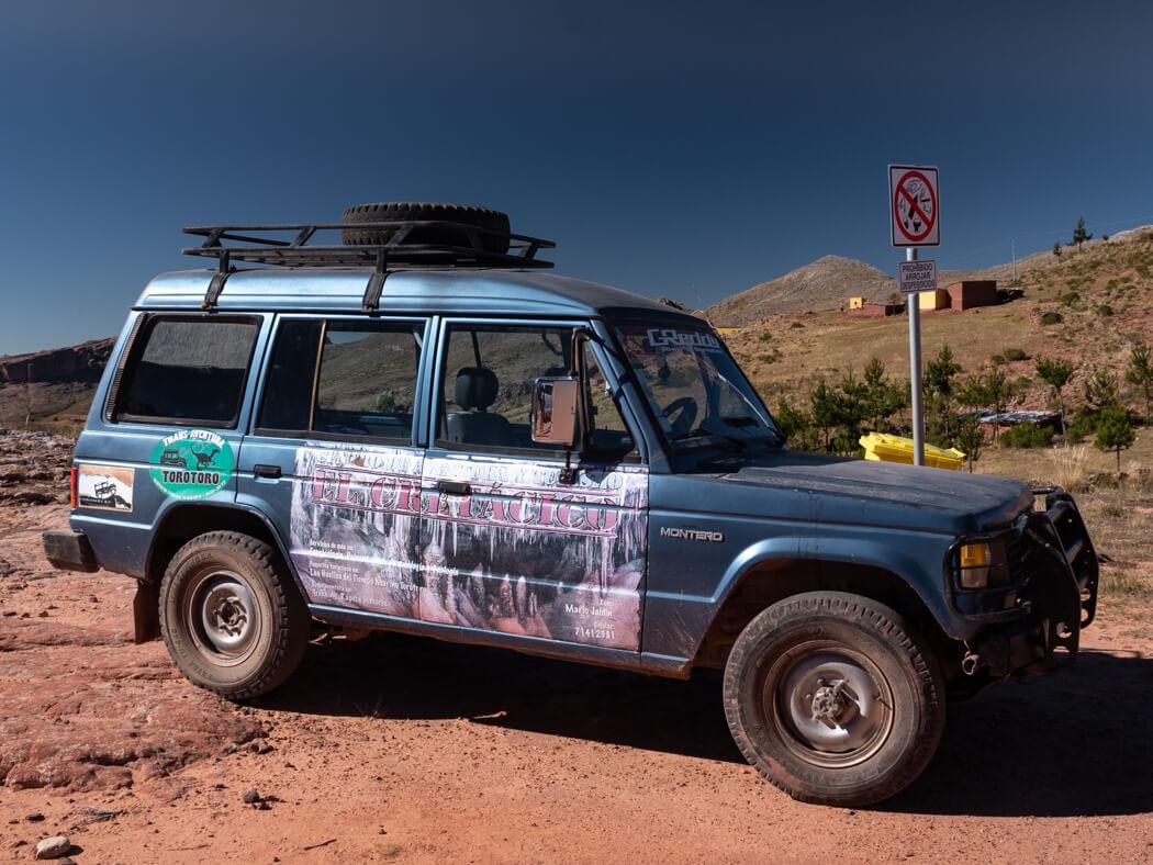 A transport jeep parked at La Ciudad de Itas, Torotoro National Park