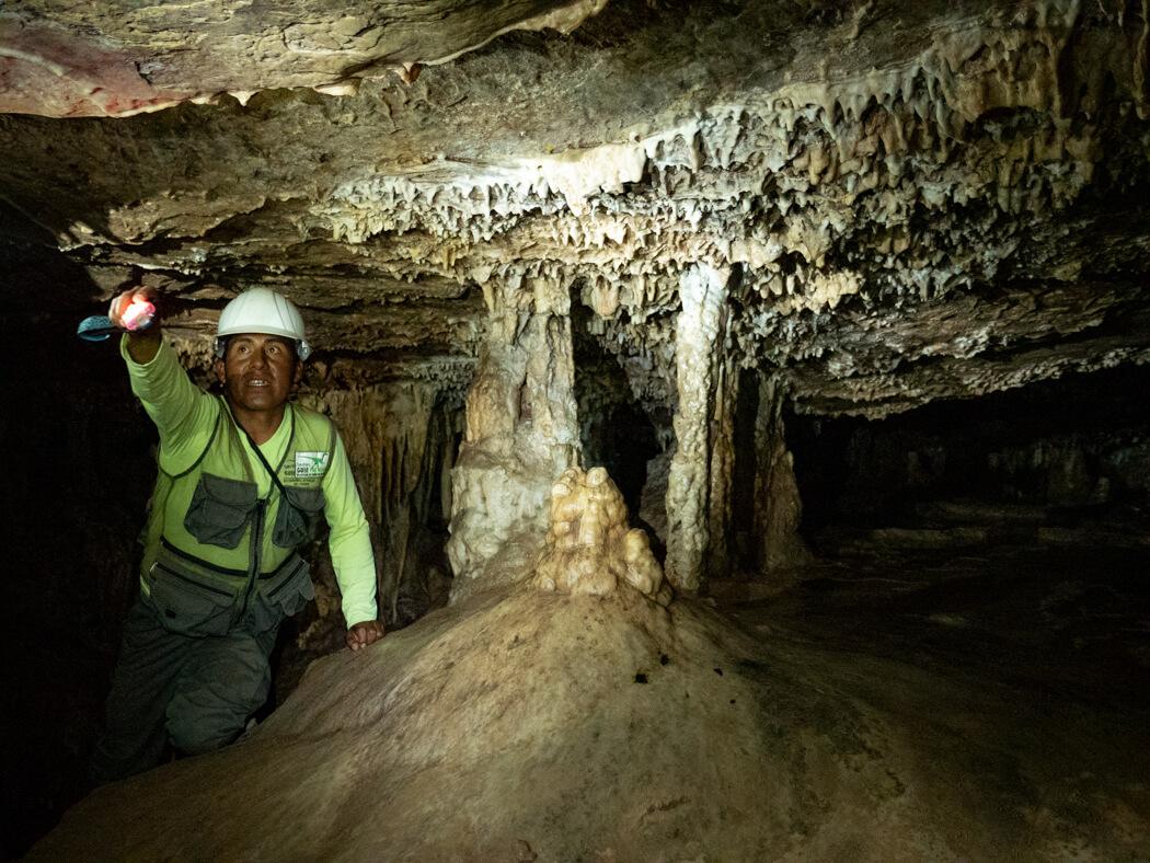 A tour guide explains the formations within Caverna de Umajalanta, Torotoro National Park, Bolivia