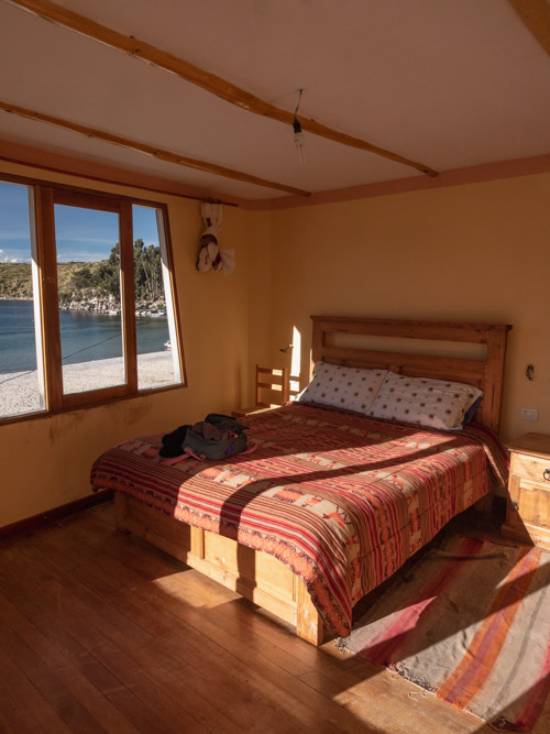 A hotel bedroom with a view of Lake Titicaca, Isla del Sol, Bolivia