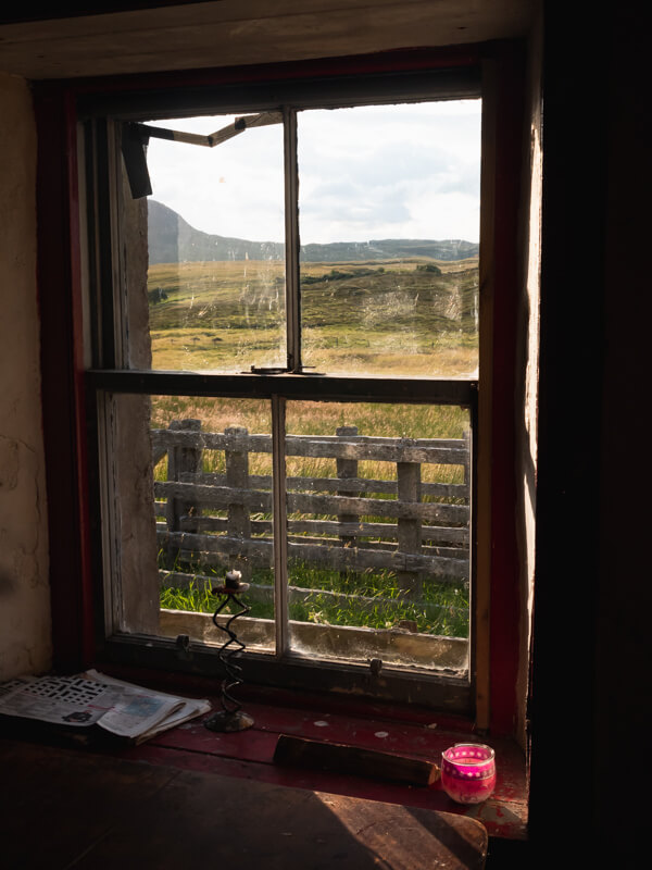 A window looking on to fields from Achnanclach Bothy, Tongue, Scotland