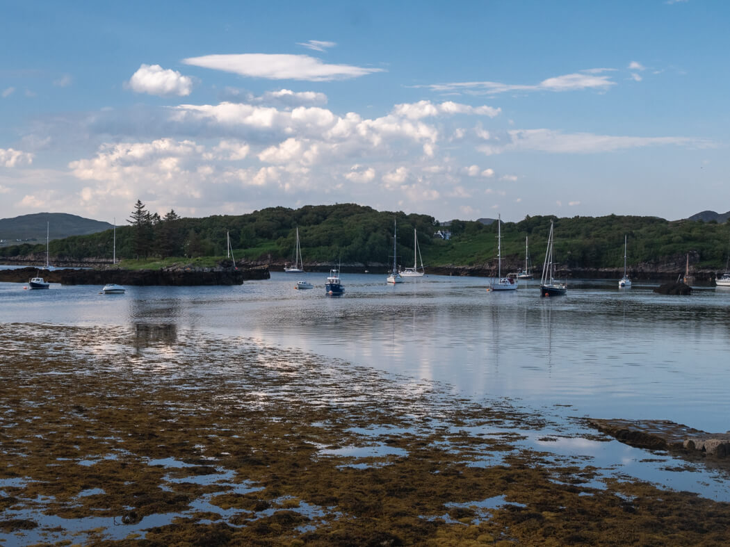 Boats sit in a jetty at Badachro, Scotland