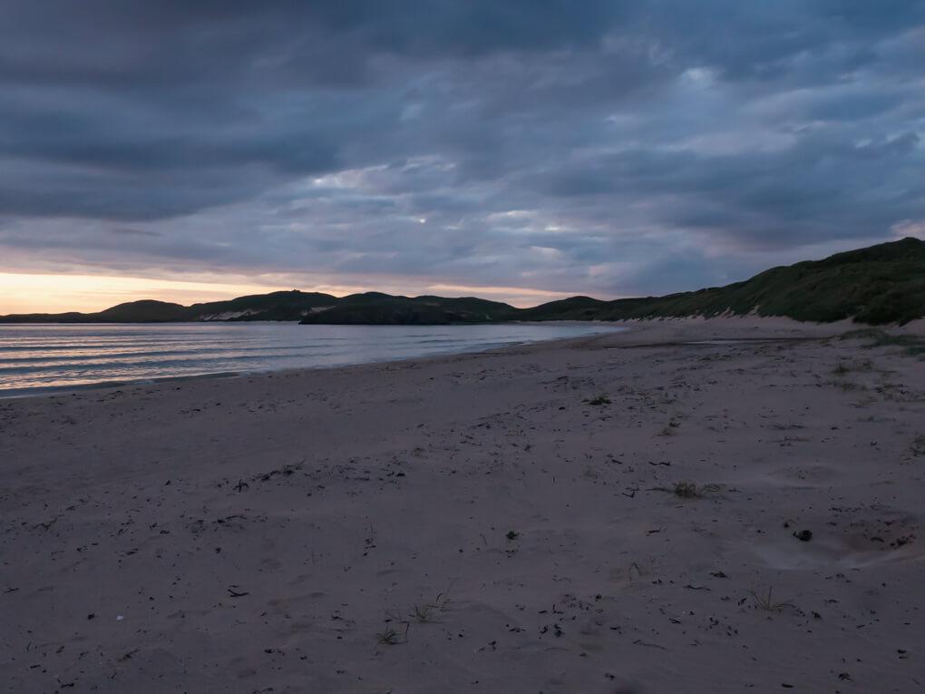 Dark clouds above Balnakeil Beach during sunset