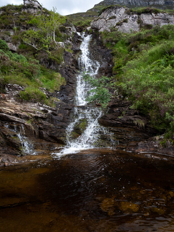 Waterfalls leading in to a large pool near Ben Hope