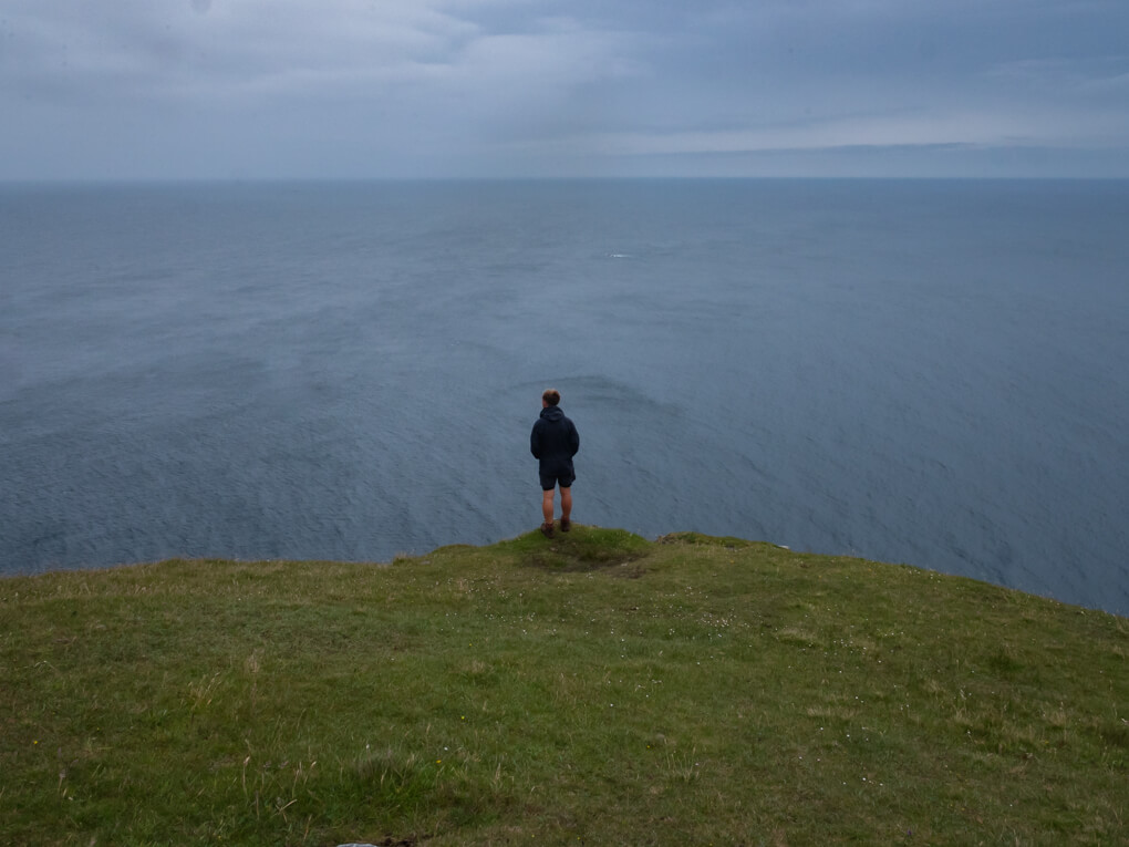 A man stands on Britain's highest sea cliffs