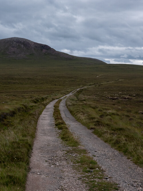 A road leads in to barren land in Cape Wrath, Scotland
