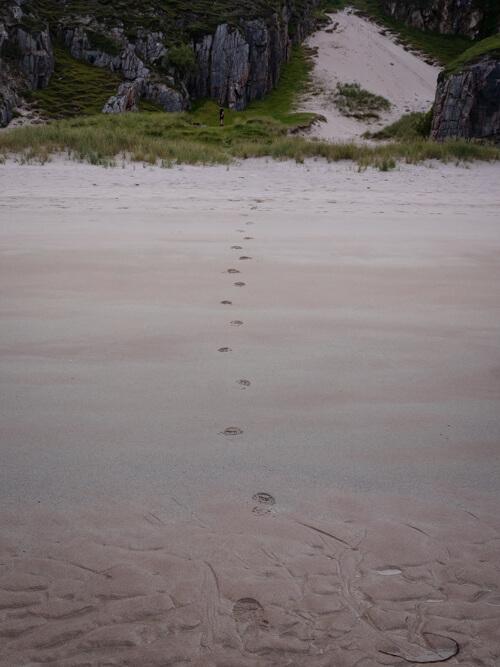 Footsteps in the sand of Ceannabeinne Beach, Scotland
