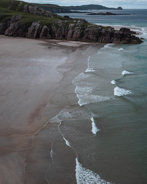 The white sands and blue waters of Ceannabeinne Beach, Scotland