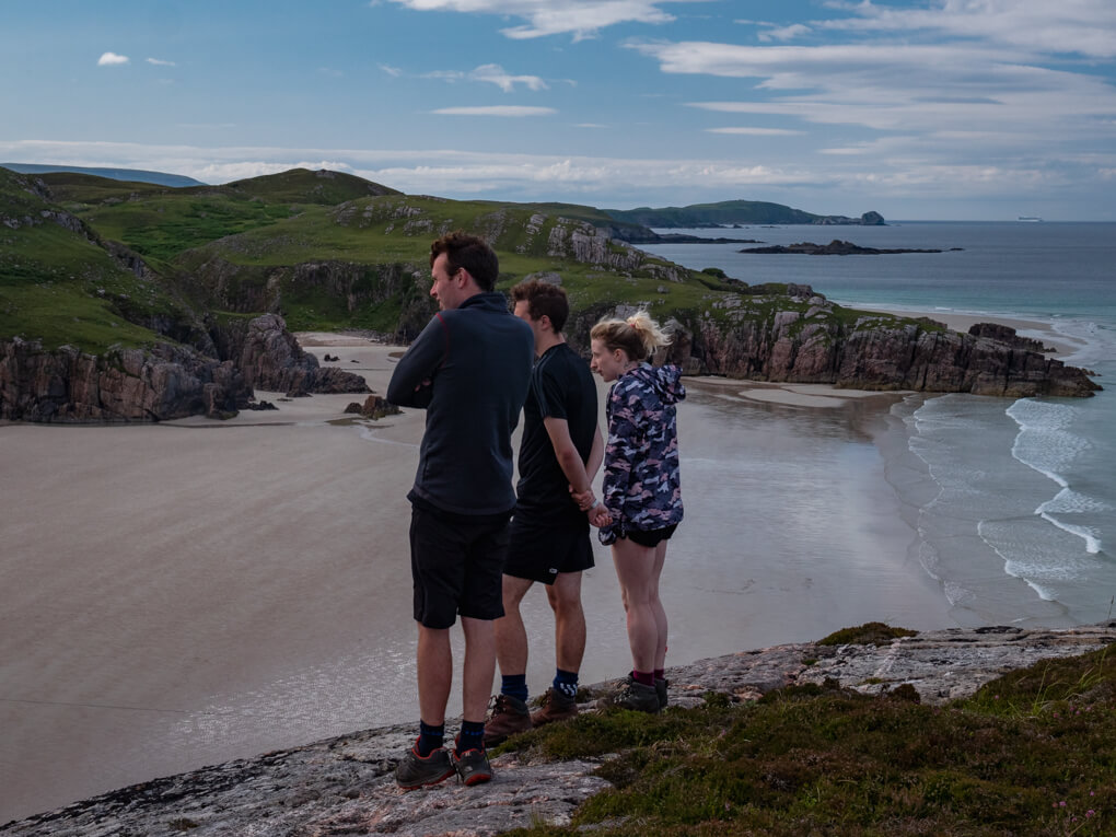 A group stand at the viewpoint for the Ceannabeinne zip line, Cieannabeinne Beach, Scotland