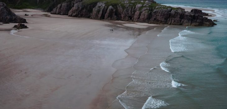 A bird's eye view of Cieannabeinne Beach, white sands and turquoise waters