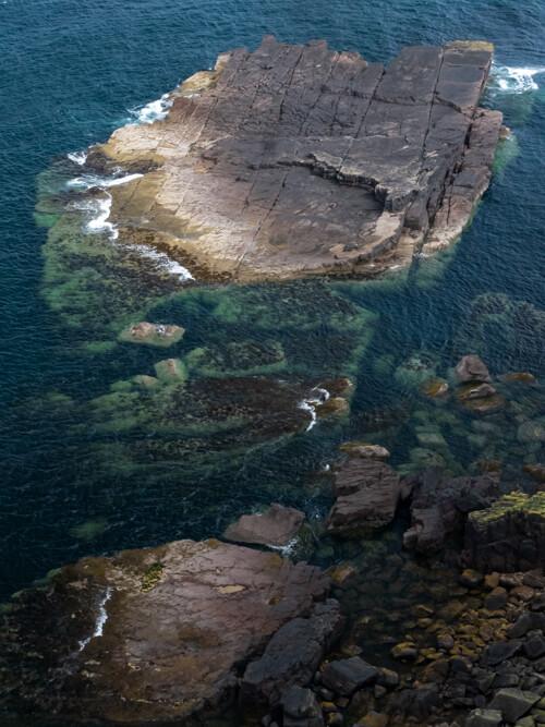 Large boulders of fallen rock in the Atlantic Ocean