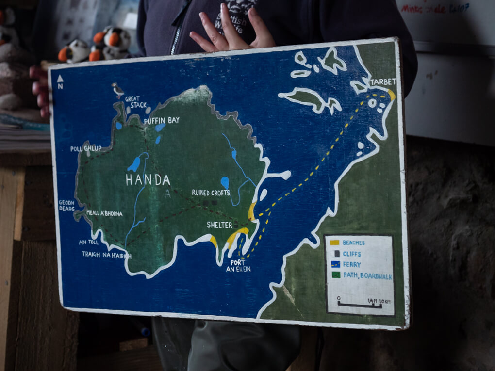 A painted board shows Handa Island and walking trails