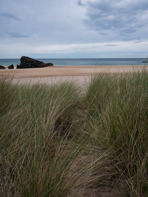 Grass dunes lead the way to Kearvaig Beach