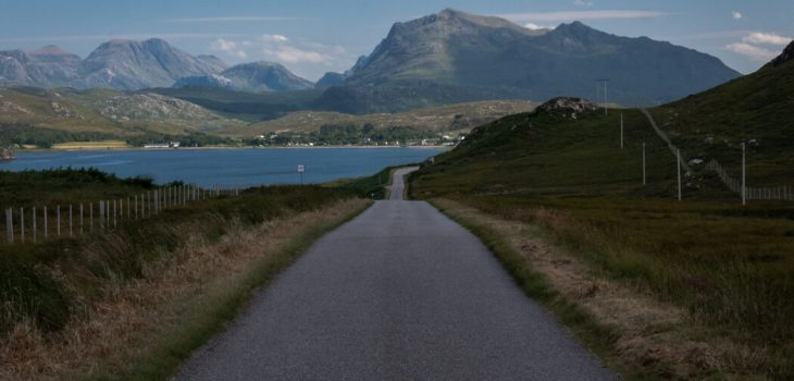 A road gives way to water and classic Scottish hills