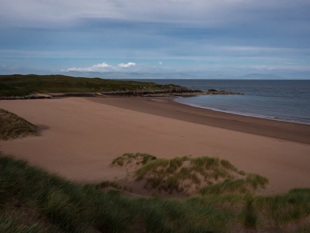 The sands of Red Point Beach with nobody on the beach