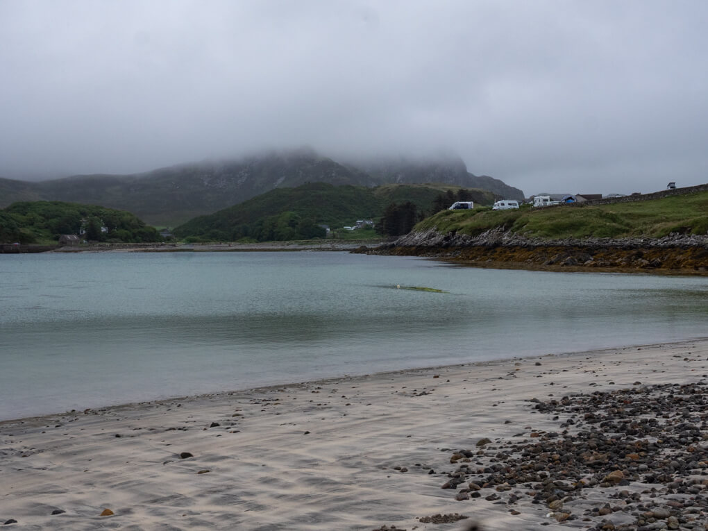Gray clouds over gray water on Scourie Bay, Scotland