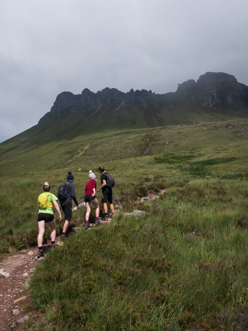 Walkers make their way up the path to Stac Pollaidh