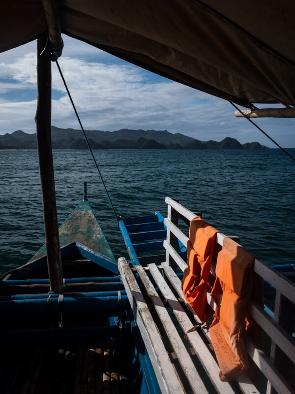A view of lifejackets on a boat with the open sea in the background, Sipalay