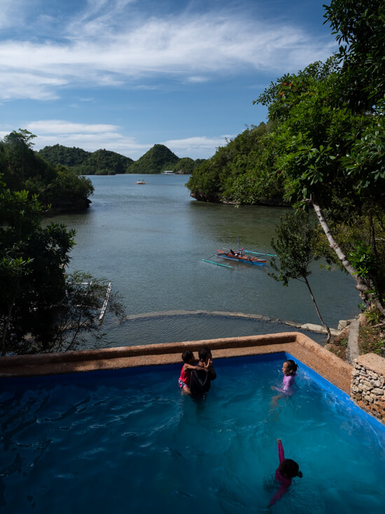A family enjoy the Latasan Island Resort pool in Sipalay