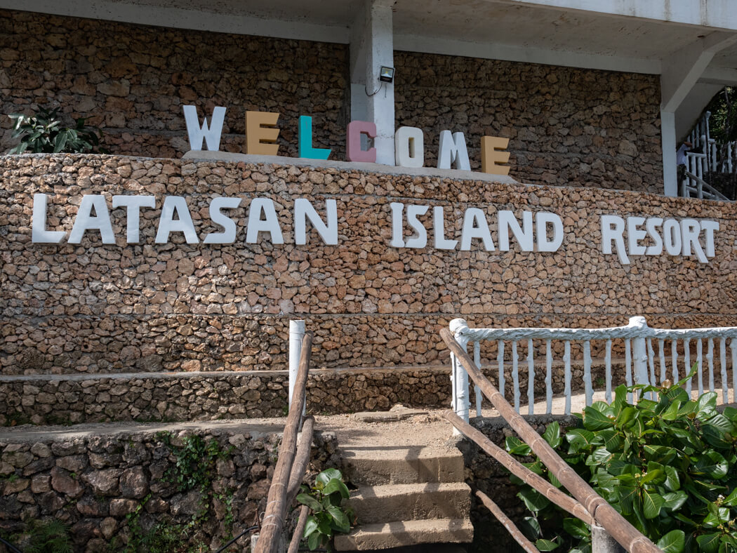 A sign welcomes visitors to Latasan Island Resort, Sipalay
