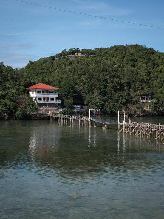 A bridge across the water to Latasan Island Resort, Sipalay