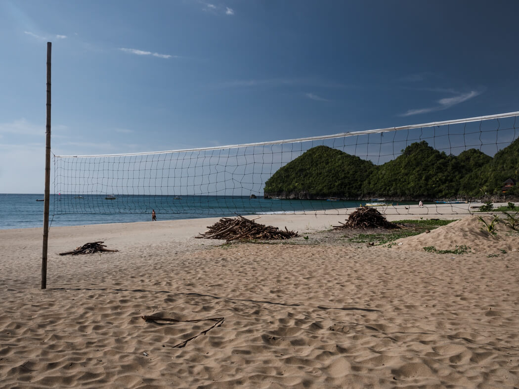 A volleyball court with the sea in the distance on Sugar Beach