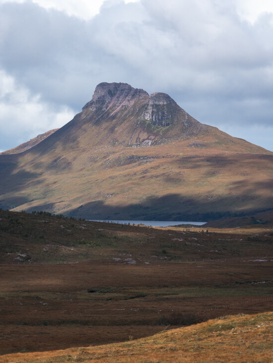 The peak of Stac Pollaidh below the clouds