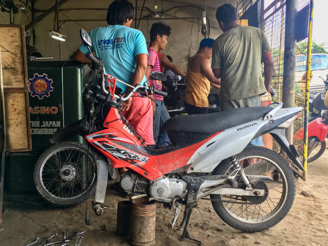 A bike on a stand being repaired at a garage in Dumaguete, Philippines