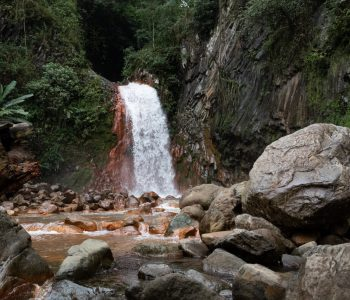 Red rock beneath the water of Pulangbato Falls, Dumaguete Tourist Spots