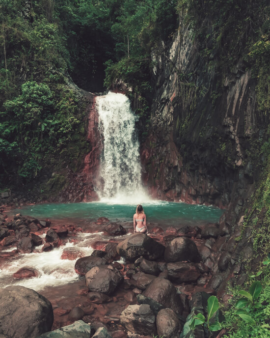 A girl enjoys the view of Pulangbato Falls, Negros